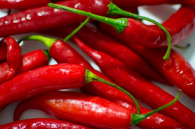 photo credit: Hot peppers are loaded with capsaicin, which binds to pain receptors in the mouth. CC0 Public Domain